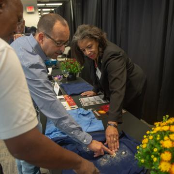 Attendees learning about Baltimore's high-tech textile industry.